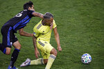 Nashville SC midfielder Randall Leal is fouled by Montreal Impact defender Jorge Luis Corrales, left, during the second half of an MLS soccer match, Tuesday, Oct. 27, 2020, in Harrison, N.J. Nashville won 1-0. (AP Photo/Adam Hunger)