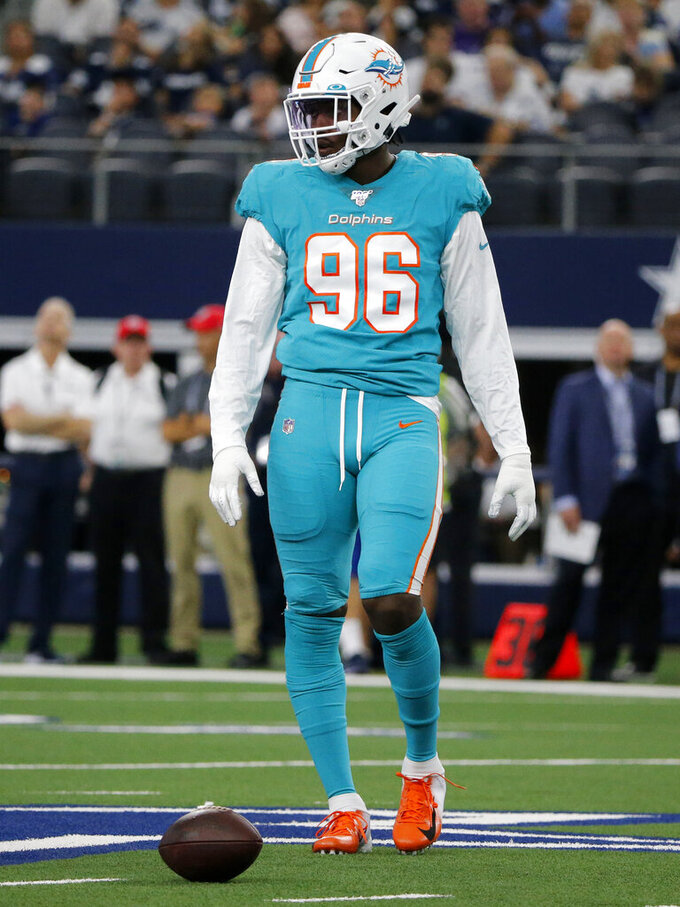 Miami Dolphins' Taco Charlton lines up against the Dallas Cowboys in the first half of a NFL football game in Arlington, Texas, Sunday, Sept. 22, 2019. (AP Photo/Michael Ainsworth)
