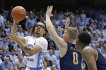 North Carolina guard Cole Anthony (2) drives to the basket against Notre Dame guard Rex Pflueger (0) during the first half of an NCAA college basketball game in Chapel Hill, N.C., Wednesday, Nov. 6, 2019. (AP Photo/Gerry Broome)