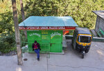A man sits on a bench in front of a closed auto-rickshaw stand during lockdown imposed to curb the spread of the coronavirus in Dharmsala, India, Saturday, May 22, 2021. (AP Photo/Ashwini Bhatia)