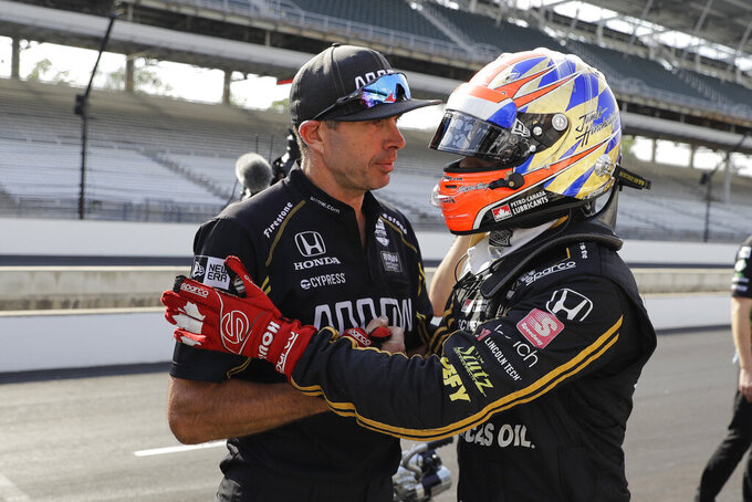 James Hinchcliffe, of Canada, talks with a crew member during qualifications for the Indianapolis 500 IndyCar auto race at Indianapolis Motor Speedway, Saturday, May 18, 2019 in Indianapolis. (AP Photo/Darron Cummings)
