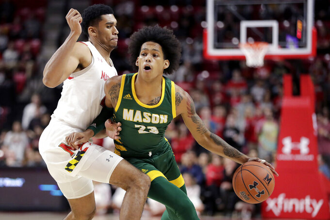 George Mason guard Javon Greene, right, drives to the basket as Maryland forward Ricky Lindo Jr. defends during the first half of an NCAA college basketball game Friday, Nov. 22, 2019, in College Park, Md. (AP Photo/Julio Cortez)