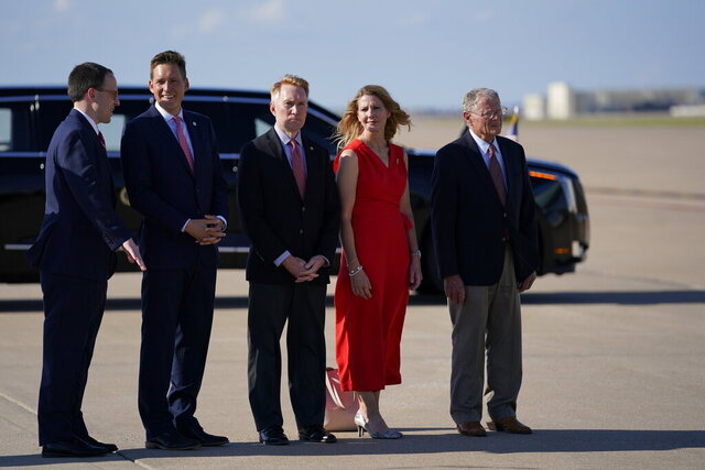 From left, Mayor G.T. Bynum, Lt. Gov. Matt Pinnell, Sen. James Lankford, R-Okla., Cindy Lankford, and Sen. Jim Inhofe, R-Okla., wait for President Donald Trump to arrive at Tulsa International Airport on Saturday, June 20, 2020, in Tulsa, Okla. (AP Photo/Evan Vucci)