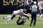 New Orleans Saints quarterback Drew Brees (9) is sacked by Chicago Bears outside linebacker Khalil Mack in the second half of an NFL wild-card playoff football game in New Orleans, Sunday, Jan. 10, 2021. (AP Photo/Brett Duke)