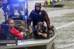 First responders with the Harris County Sheriff's Office, Texas Game Warden, and Huffman Fire Department rescued people from flooded homes in the Lochshire neighborhood Friday, Sept. 20, 2019, in Huffman, Texas. Emergency workers used boats Friday to rescue about 60 residents of a Houston-area community still trapped in their homes by floodwaters following one of the wettest tropical cyclones in U.S. history. (Godofredo A. Vásquez/Houston Chronicle via AP)