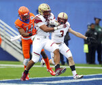 Boston College running back AJ Dillon (2) scores a touchdown ahead of Boise State cornerback Tyler Horton (14) during the first half of the First Responder Bowl NCAA football game Wednesday, Dec. 26, 2018, in Dallas. (AP Photo/Richard W. Rodriguez)