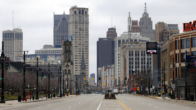 In this March 24, 2020 file photo, Woodward Avenue is shown nearly empty in Detroit. Before the coronavirus showed up, downtown Detroit was returning to its roots as a vibrant city center, motoring away from its past as the model of urban ruin. Now, with the coronavirus forcing many office workers to their homes in the suburbs, those who remain wonder if revitalization will ever return. (AP Photo/Paul Sancya)