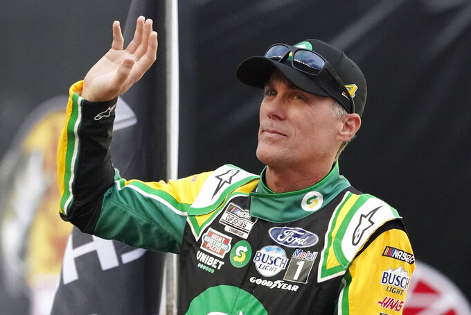 Kevin Harvick waves to fans before a NASCAR Cup Series auto race at Bristol Motor Speedway Saturday, Sept. 18, 2021, in Bristol, Tenn. (AP Photo/Mark Humphrey)