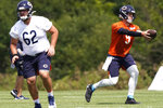 Chicago Bears quarterback Nick Foles, right, works with offensive line Corey Levin during an NFL football camp practice in Lake Forest, Ill., Sunday, Aug. 23, 2020. (AP Photo/Nam Y. Huh, Pool)
