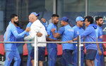 Indian cricketers greet each other after their team lost the Cricket World Cup semifinal match between India and New Zealand at Old Trafford in Manchester, Wednesday, July 10, 2019. (AP Photo/Rui Vieira)