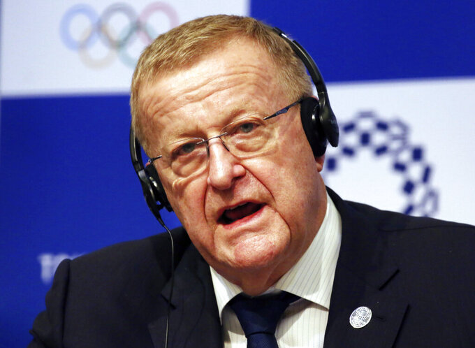 """FILE - In this Dec. 5, 2018, file photo, John Coates, the leader of the IOC's coordination commission for the Tokyo Olympics, speaks during a press conference in Tokyo. Coates said there is no May deadline to cancel the games and he remains confident the event will go ahead despite sports coming to a virtual standstill globally amid the coronavirus outbreak. Coates told the Sydney Morning Herald newspaper Monday, March 16, 2020: """"It's all proceeding to start on the 24th of July.""""(AP Photo/Koji Sasahara, File)"""