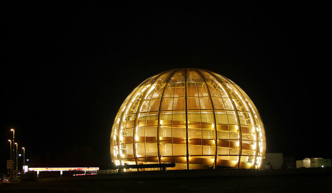 "FILE - In this March 30, 2010 file picture the globe of the European Organization for Nuclear Research, CERN, is illuminated outside Geneva, Switzerland. With COVID-19, the race to space and climate change high on many minds, a new ""do tank"" in Geneva bankrolled by the Swiss government is gearing up to develop long-term projects like creating a global court for scientific disputes and a Manhattan Project-style effort to rid excess carbon from the atmosphere. (AP Photo/Anja Niedringhaus, file)"