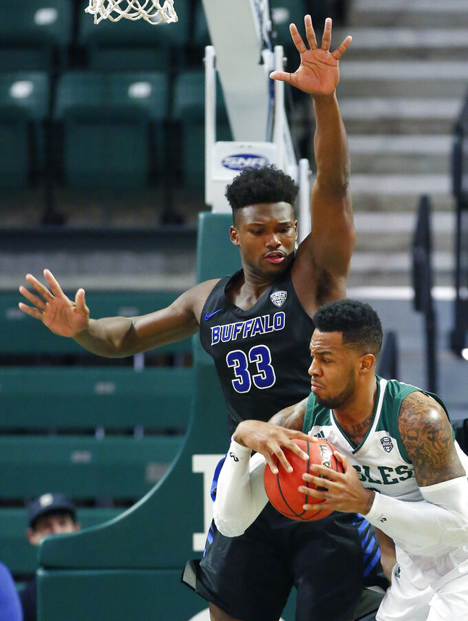 Buffalo forward Nick Perkins (33) guards Eastern Michigan center James Thompson IV during the first half of an NCAA college basketball game Friday, Jan. 4, 2019, in Ypsilanti, Mich. Buffalo defeated Eastern Michigan 74-58. (AP Photo/Duane Burleson)