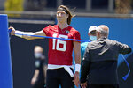Jacksonville Jaguars quarterback Trevor Lawrence (16) stretches out during an NFL football rookie minicamp, Saturday, May 15, 2021, in Jacksonville, Fla. (AP Photo/John Raoux)