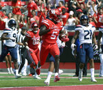 Houston wide receiver Marquez Stevenson (5) runs into the end zone for a touchdown during the first half of an NCAA college football game against Arizona, Saturday, Sept. 8, 2018, in Houston. (AP Photo/Eric Christian Smith)