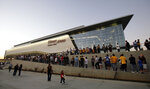 FILE - In this Oct. 24, 2008, file photo, fans line up for the grand opening of the Citizens Business Bank Arena before the Los Angeles Lakers play the Oklahoma City Thunder in an NBA preseason basketball game in Ontario, Calif. The crippling coronavirus pandemic has brought the entire world — including the sports world — to a standstill, and it shows no sign of going away anytime soon. The most obvious change in the short term  will be the implementation of social distancing, something that already has permeated everyday life. Ticket sales will be capped and fans will be given an entrance time to prevent crowds at the gate. (AP Photo/Francis Specker, File)