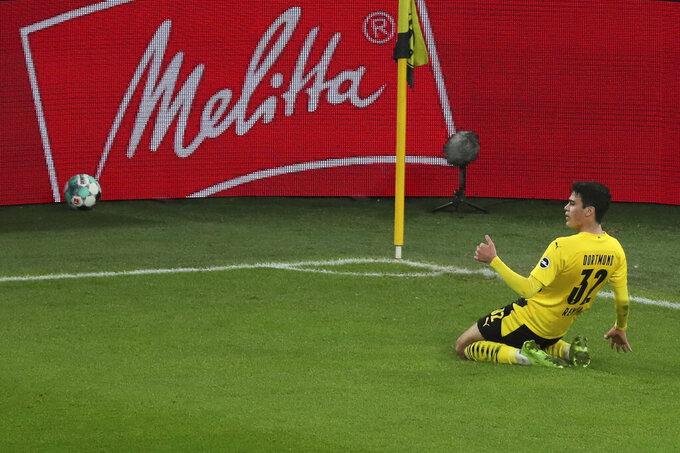 Dortmund's Giovanni Reyna celebrates during the German Bundesliga soccer match between Borussia Dortmund and VfB Stuttgart in Dortmund, Germany, Saturday, Dec. 12, 2020. (Focke Strangmann/Pool via AP)
