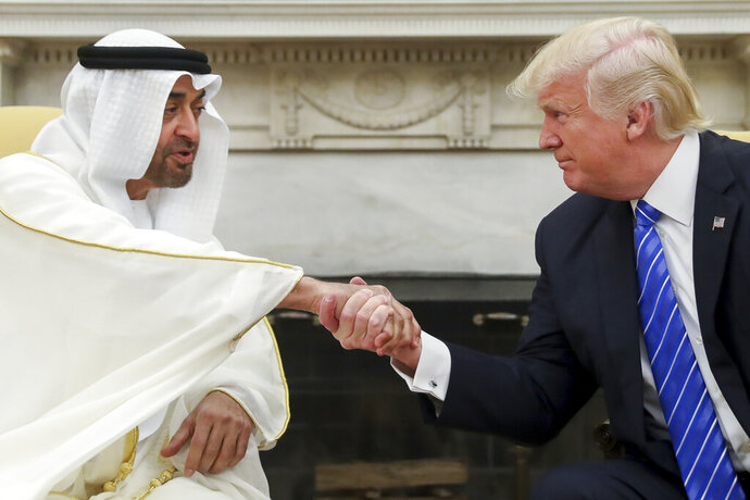 FILE - In this May 15, 2017, file photo, President Donald Trump shakes hands with Abu Dhabi's crown prince, Sheikh Mohammed bin Zayed Al Nahyan, in the White House in Washington. Sheikh Mohammed, one of the most-powerful leaders in the United Arab Emirates, has found himself entangled in special counsel Robert Mueller's report on U.S. President Donald Trump and Russian interference in America's 2016 election. (AP Photo/Andrew Harnik, File)