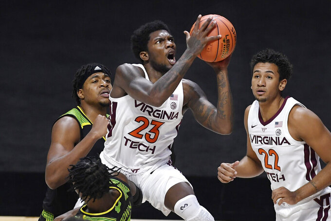 Virginia Tech's Tyrece Radford is fouled by South Florida's Justin Brown, bottom, as he shoots in the second half of an NCAA college basketball game, Sunday, Nov. 29, 2020, in Uncasville, Conn. (AP Photo/Jessica Hill)