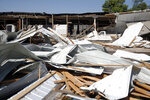 The roof and back half of the building is exposed at Camden Amusement in northwest Cedar Rapids, Iowa, on Wednesday, Aug. 12, 2020, following damaging winds Monday. Hundreds of thousands of households in Iowa and Illinois remained without electricity Wednesday, two days after a rare wind storm that hit the Midwest devastated parts of the power grid, flattened valuable corn fields and killed several people. (Liz Martin/The Gazette via AP)