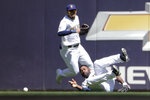 Milwaukee Brewers' Jackie Bradley Jr., right, is unable to make a diving catch during the sixth inning of a baseball game against the Pittsburgh Pirates, Sunday, June 13, 2021, in Milwaukee. (AP Photo/Aaron Gash)