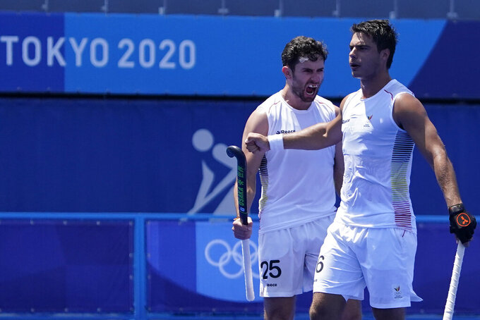 Belgium defender Loick Fanny A Luypaert (25) celebrates after Belgium defender Alexander Robby P Hendrickx, right, scored against the Netherlands during a men's field hockey match at the 2020 Summer Olympics, Saturday, July 24, 2021, in Tokyo, Japan. (AP Photo/John Locher)