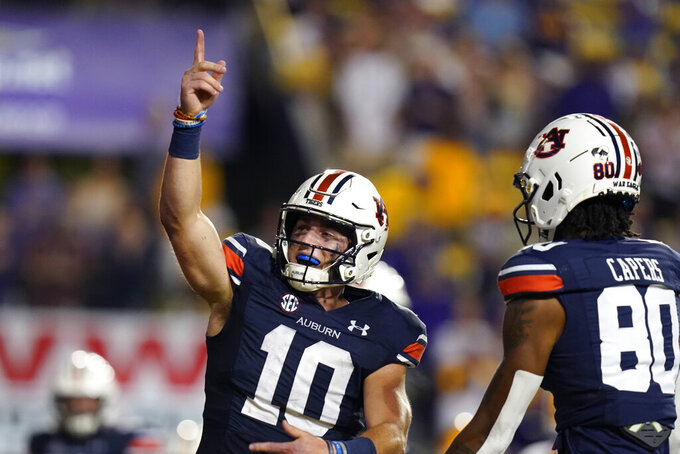 Auburn quarterback Bo Nix (10) celebrates after scoring a touchdown in the second half of an NCAA college football game against Auburn in Baton Rouge, La., Saturday, Oct. 2, 2021. Auburn won 24-19. (AP Photo/Gerald Herbert)
