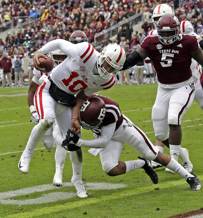 Mississippi Rebels quarterback Jordan Ta'amu (10) rushes for a touchdown as Texas A&M defensive back Larry Pryor (11) hits him at the goal line during the first half of an NCAA college football game Saturday, Nov. 10, 2018, in College Station, Texas. (AP Photo/David J. Phillip)