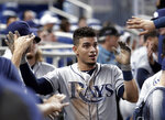 Tampa Bay Rays' Willy Adames is congratulated in the dugout after scoring on a double by Anthony Bemboom in the second inning during a baseball game against the Miami Marlins, Wednesday, May 15, 2019, in Miami. (AP Photo/Lynne Sladky)