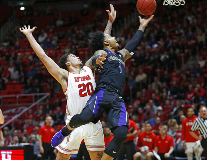 Washington guard David Crisp (1) lays the ball up as Utah forward Timmy Allen (20) defends during the first half of an NCAA college basketball game Thursday, Jan., 10, 2019, in Salt Lake City. (AP Photo/Rick Bowmer)