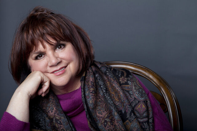 FILE - In this Sept. 17, 2013 file photo, American musician Linda Ronstadt poses in New York to promote the release of her memoir