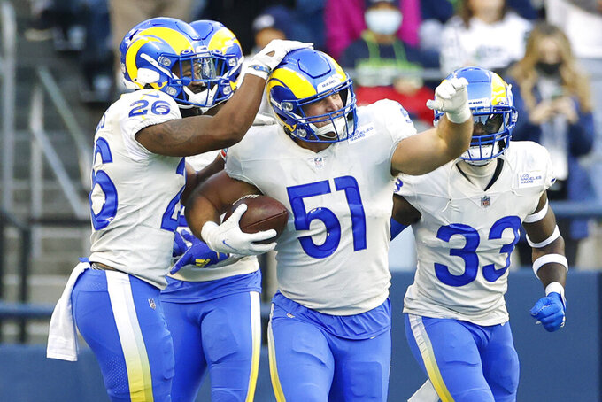 Los Angeles Rams linebacker Troy Reeder (51) celebrates after he intercepted a pass against the Seattle Seahawks during the first half of an NFL football game, Thursday, Oct. 7, 2021, in Seattle. (AP Photo/Craig Mitchelldyer)