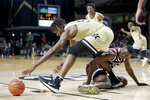 Vanderbilt forward Ejike Obinna, left, reaches for the ball over Texas A&M forward Jonathan Aku in the second half of an NCAA college basketball game Saturday, Jan. 11, 2020, in Nashville, Tenn. Texas A&M won 69-50. (AP Photo/Mark Humphrey)