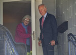 Former U.S. Vice President Joe Biden makes a stop to see Anne Kearns who lives in his childhood home in Scranton Pa., on Wednesday, Oct. 23, 2019. (Jason Farmer/The Times-Tribune via AP)