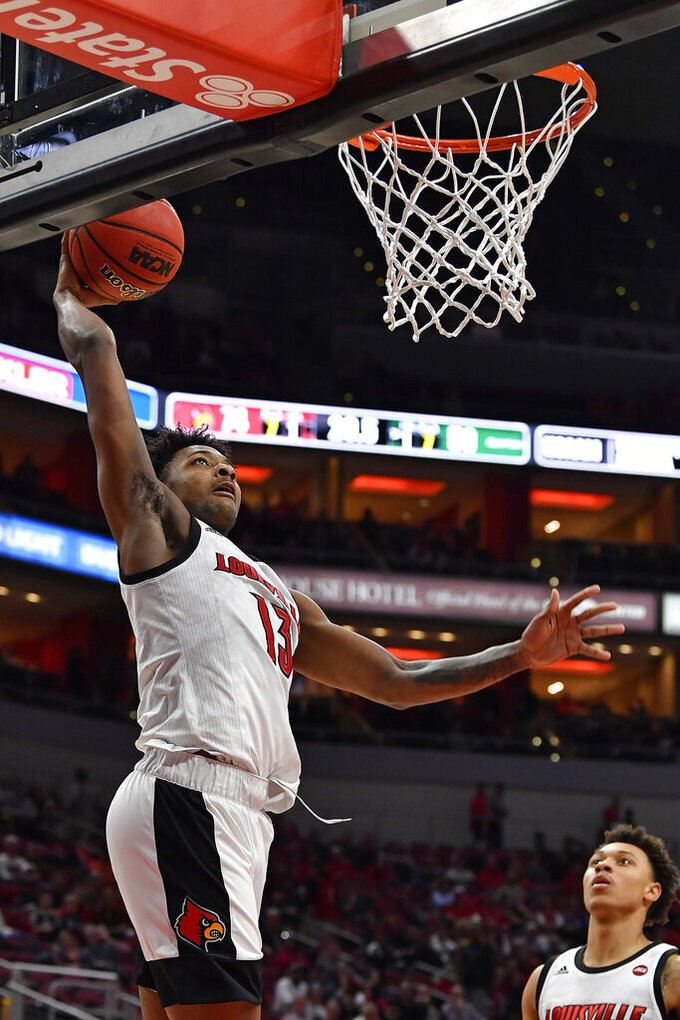 Louisville guard David Johnson (13) goes up for a layup during the second half of an NCAA college basketball game against South Carolina Upstate in Louisville, Ky., Wednesday, Nov. 20, 2019. Louisville won 76-50. (AP Photo/Timothy D. Easley)