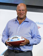 New Carolina Panthers owner David Tepper poses for a photo during a news conference at Bank of America Stadium in Charlotte, N.C., Tuesday, July 10, 2018. Tepper finalized his purchase of the team on Monday. (AP Photo/Chuck Burton)
