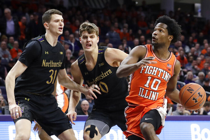 Illinois guard Andres Feliz, right, drives to the basket against Northwestern forwards Robbie Beran, left, and Miller Kopp during the first half of an NCAA college basketball game in Evanston, Ill., Thursday, Feb. 27, 2020. (AP Photo/Nam Y. Huh)