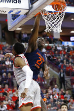 Illinois' Kofi Cockburn, right, dunks over Ohio State's Andre Wesson during the first half of an NCAA college basketball game Thursday, March 5, 2020, in Columbus, Ohio. (AP Photo/Jay LaPrete)