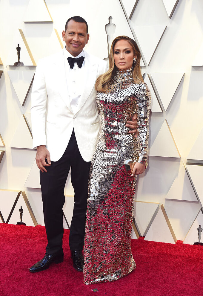 """FILE - Alex Rodriguez, left, and Jennifer Lopez arrive at the Oscars in Los Angeles on Feb. 24, 2019. Lopez and Rodriguez told the """"Today"""" show Thursday, April 15,2021, in a joint statement that they are calling off their two-year engagement. (Photo by Jordan Strauss/Invision/AP, File)"""