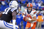 Syracuse's Tommy DeVito (13) carries the ball towards Duke's Victor Dimukeje (51) during the first half of an NCAA college football game in Durham, N.C., Saturday, Nov. 16, 2019. (AP Photo/Ben McKeown)