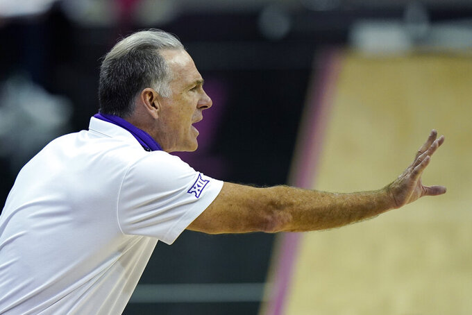 TCU head coach Jamie Dixon talks to his players during the second half of an NCAA college basketball game against Tulsa, Saturday, Nov. 28, 2020, in Kansas City, Mo. (AP Photo/Charlie Riedel)