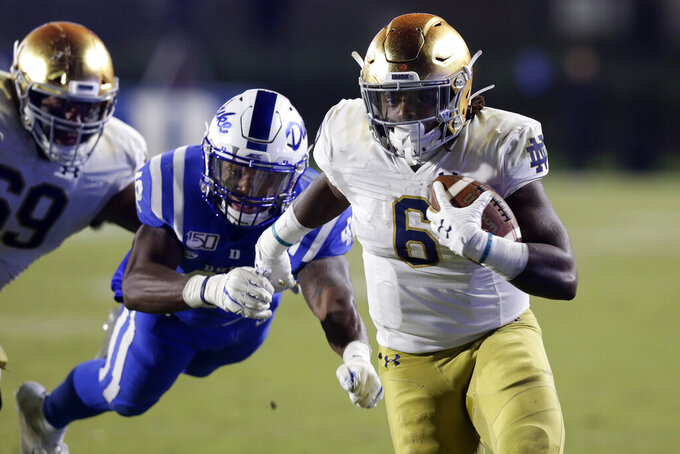 Duke linebacker Shaka Heyward (42) dives for Notre Dame running back Tony Jones Jr. (6) during the second half of an NCAA college football game in Durham, N.C., Saturday, Nov. 9, 2019. (AP Photo/Gerry Broome)