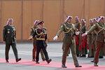 Jordan's King Abdullah II, third left, reviews an honor guard before giving a speech to Parliament in Amman, Jordan, Sunday, Nov. 10, 2019. The king announced