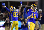 FILE - In this Jan. 12, 2019, file photo, Los Angeles Rams quarterback Jared Goff celebrates after a touchdown by running back C.J. Anderson during the second half in an NFL divisional football playoff game against the Dallas Cowboys in Los Angeles. The wide-eyed, talented Goff will try to lead his Rams past the grizzled, 41-year-old Tom Brady, who is looking to guide the Patriots to their sixth Super Bowl victory.  (AP Photo/Mark J. Terrill, File)