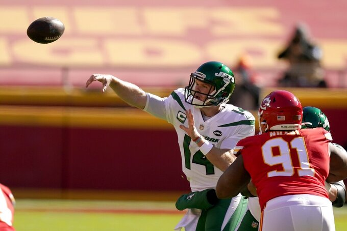 New York Jets quarterback Sam Darnold (14) throws a pass under pressure from Kansas City Chiefs defensive tackle Derrick Nnadi (91) in the first half of an NFL football game on Sunday, Nov. 1, 2020, in Kansas City, Mo. (AP Photo/Charlie Riedel)