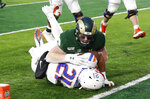 Colorado State defensive lineman Toby McBride, top, stops Boise State running back Andrew Van Buren just short of the goal line in the second half of an NCAA college football game Friday, Nov. 29, 2019, in Fort Collins, Colo. Boise State won 31-24. (AP Photo/David Zalubowski)