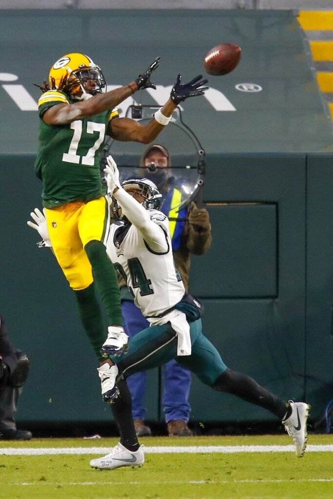 Green Bay Packers' Davante Adams catches a touchdown pass during the first half of an NFL football game against the Philadelphia Eagles Sunday, Dec. 6, 2020, in Green Bay, Wis. (AP Photo/Matt Ludtke)