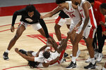 Houston guard Tramon Mark, bottom, celebrates his game-winning 3-point basket with teammates during the second half of an NCAA college basketball game against Memphis, Sunday, March 7, 2021, in Houston. (AP Photo/Eric Christian Smith)