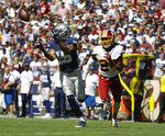 Dallas Cowboys wide receiver Devin Smith reaches out to make a catch and score against Washington Redskins cornerback Josh Norman (24) in the first half of an NFL football game, Sunday, Sept. 15, 2019, in Landover, Md. (AP Photo/Evan Vucci)