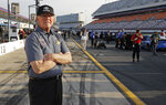Team owner Joe Gibbs looks down pit road before qualifications for Sunday's NASCAR Cup Series auto race at Charlotte Motor Speedway in Concord, N.C., Thursday, May 23, 2019. (AP Photo/Chuck Burton)